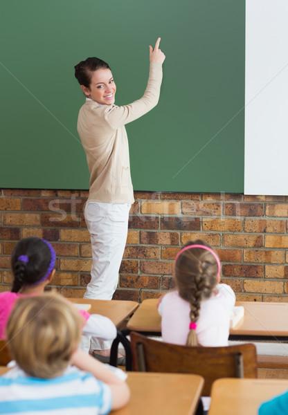Aranyos iskolás hallgat tanár osztályterem általános iskola Stock fotó © wavebreak_media
