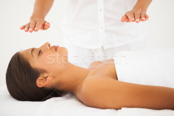 Beautiful brunette getting reiki therapy Stock photo © wavebreak_media