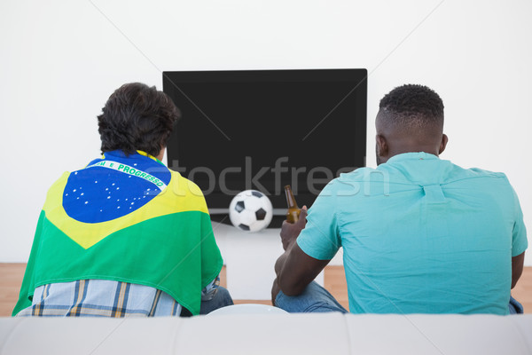 Brazilian soccer fans watching tv Stock photo © wavebreak_media