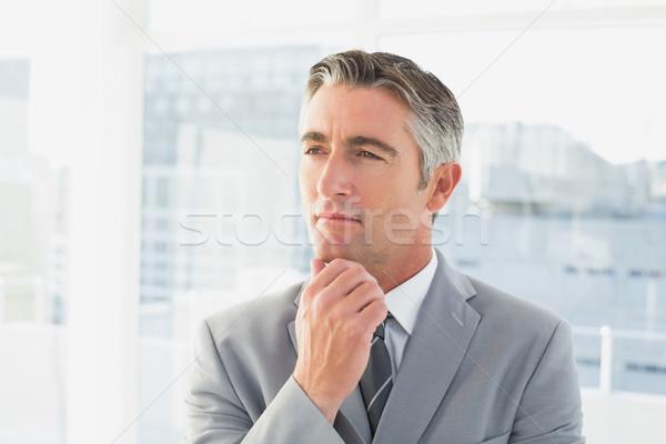 Empresário pensando trabalhar negócio escritório sorrir Foto stock © wavebreak_media