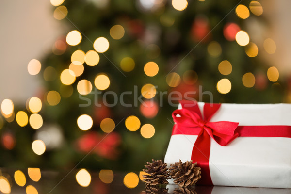 Focus on christmas gift and pine cone Stock photo © wavebreak_media