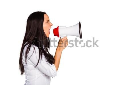 Young woman shouting through megaphone Stock photo © wavebreak_media