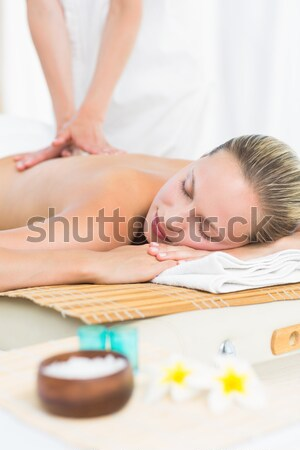 Woman receiving shoulder massage at spa center Stock photo © wavebreak_media