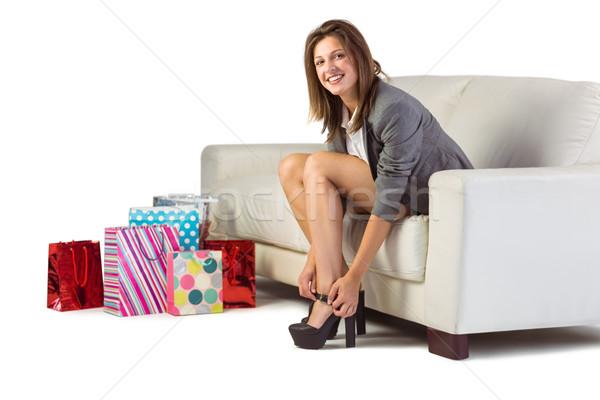 Jólöltözött nő ül kanapé elvesz el Stock fotó © wavebreak_media