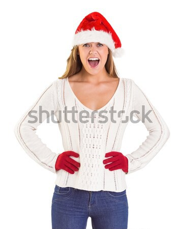 Festive brunette in boxing gloves punching Stock photo © wavebreak_media