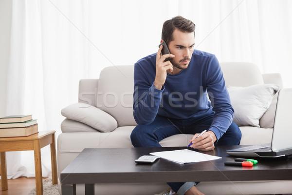 Młody człowiek laptop domu salon Zdjęcia stock © wavebreak_media