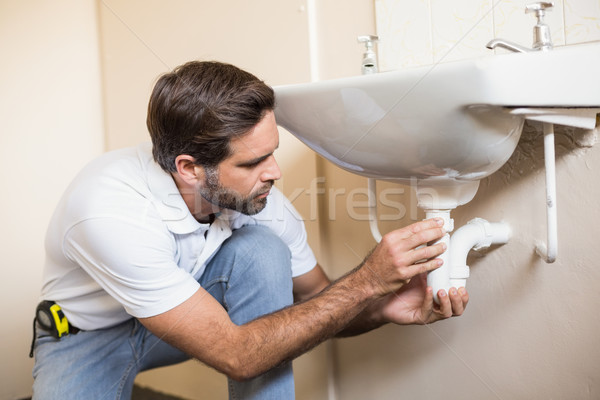 Plumber fixing the sink in a bathroom Stock photo © wavebreak_media