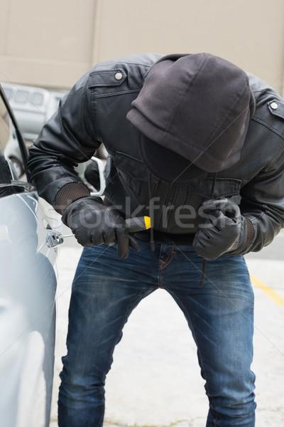 Stock fotó: Tolvaj · autó · csavarhúzó · férfi · kalap · biztosítás
