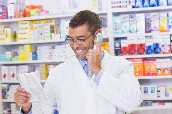 Happy pharmacist on the phone  Stock photo © wavebreak_media