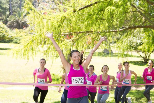 Smiling women running for breast cancer awareness Stock photo © wavebreak_media