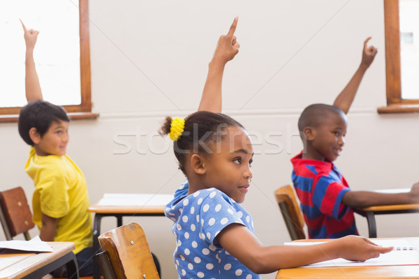 Stock photo: Pupils raising hand in classroom