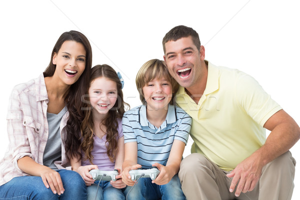 Happy family playing video game together Stock photo © wavebreak_media