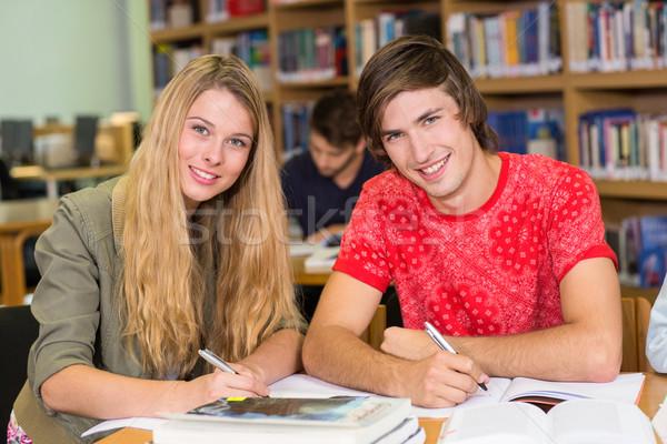 Collège élèves devoirs bibliothèque portrait homme Photo stock © wavebreak_media