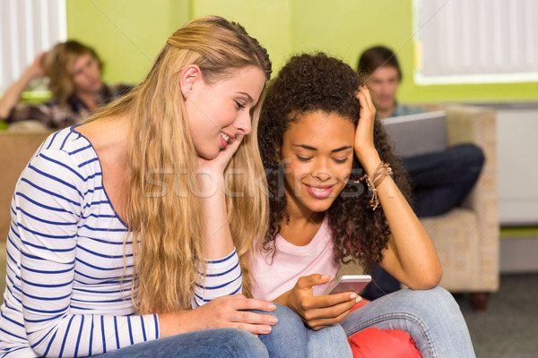 Young women text messaging in office Stock photo © wavebreak_media