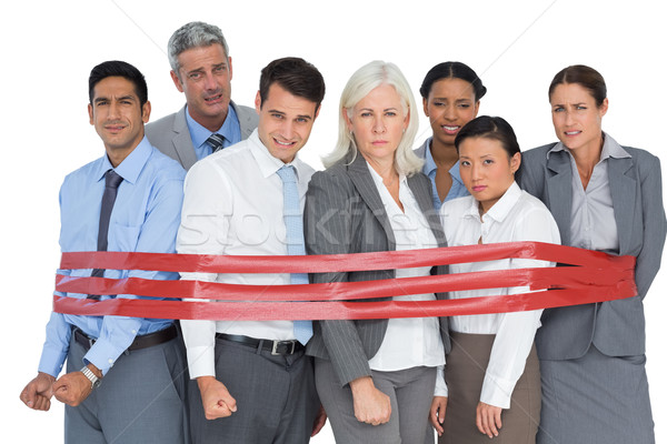 Unhappy business people surrounding by red strip  Stock photo © wavebreak_media