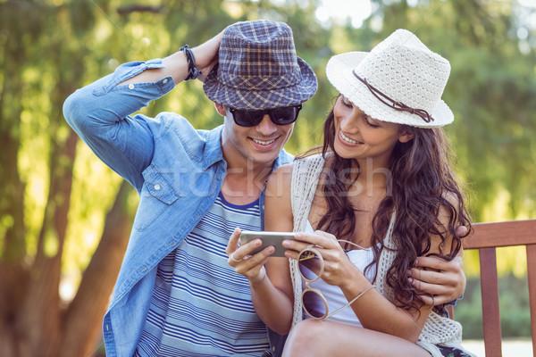 Cute couple looking at their selfies  Stock photo © wavebreak_media