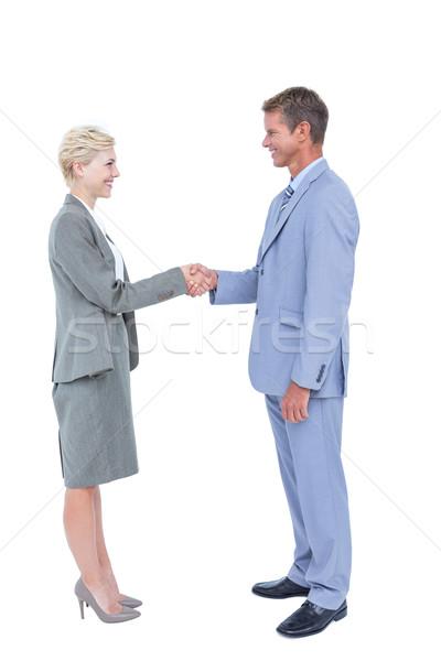 Mosolyog üzletemberek kézfogás fehér képernyő férfi Stock fotó © wavebreak_media