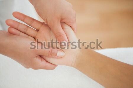 Manicurist washing customers hand Stock photo © wavebreak_media