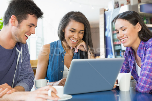 Young students doing assignment on laptop together Stock photo © wavebreak_media