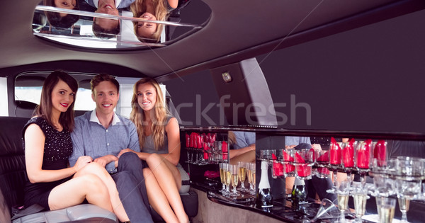 Pretty girls with ladies man in the limousine Stock photo © wavebreak_media