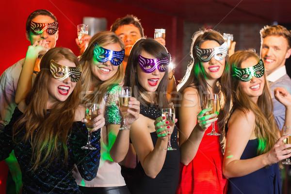 Amigos máscaras potável champanhe boate homem Foto stock © wavebreak_media