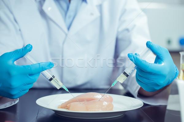 Food scientist injecting raw chicken Stock photo © wavebreak_media