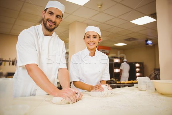Team of bakers kneading dough Stock photo © wavebreak_media
