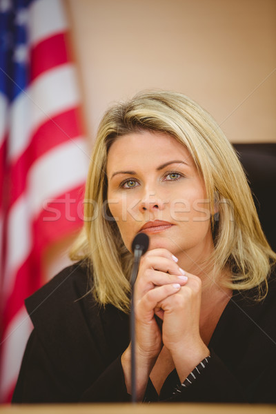 Portrait of a serious judge with american flag behind her Stock photo © wavebreak_media