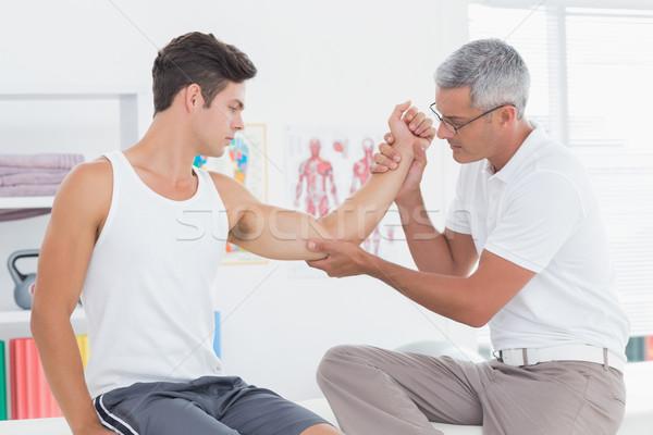医師 調べる 患者 腕 医療 オフィス ストックフォト © wavebreak_media