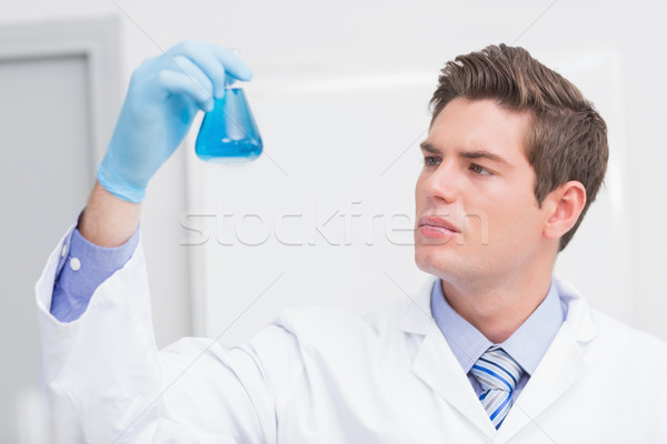 Scientist looking attentively at the beaker Stock photo © wavebreak_media