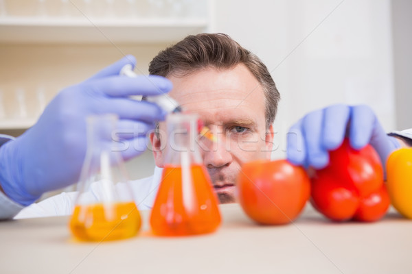Scientist injecting vegetables  Stock photo © wavebreak_media
