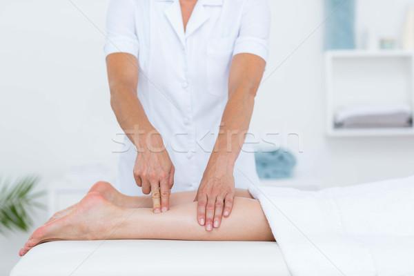 Physiotherapist doing leg massage Stock photo © wavebreak_media