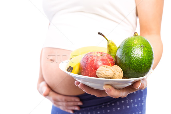 Pregnant woman showing fruit and veg  Stock photo © wavebreak_media