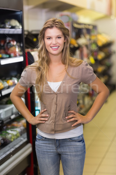 Portrait of a pretty blonde woman with hands on hips  Stock photo © wavebreak_media