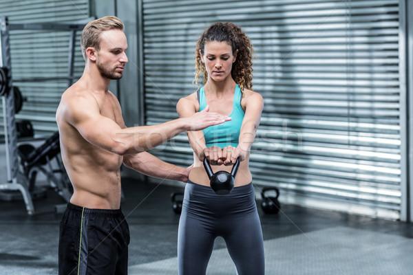 筋肉の トレーナー を見る リフト 用心深い 女性 ストックフォト © wavebreak_media