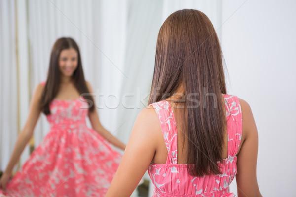 Smiling woman trying on a dress Stock photo © wavebreak_media