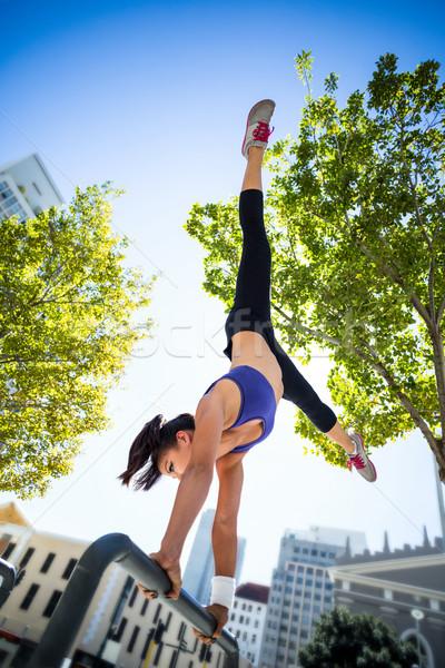 Athletic woman performing handstand on bar Stock photo © wavebreak_media