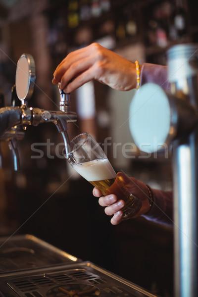 Primer plano bar cariñoso relleno cerveza bombear Foto stock © wavebreak_media