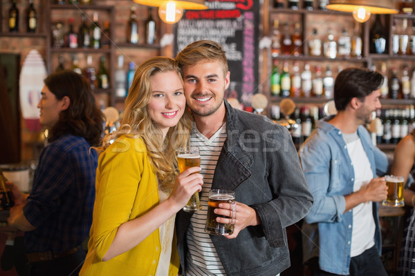 Jonge vrienden bier bril pub Stockfoto © wavebreak_media