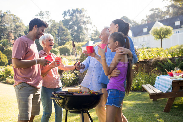 Family laughing and talking while preparing barbecue in the park Stock photo © wavebreak_media