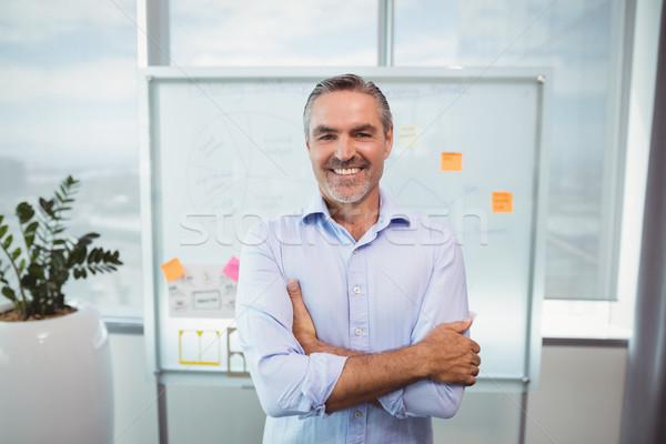 肖像 笑みを浮かべて 執行 立って オフィス ストックフォト © wavebreak_media