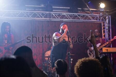 Női előadó énekel zene esemény éjszakai klub Stock fotó © wavebreak_media