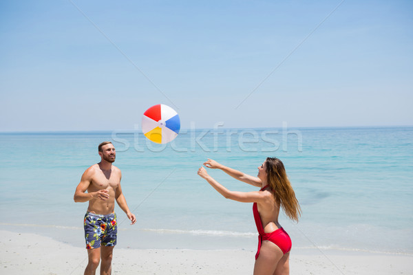 Stock photo: Couple playing with beach ball