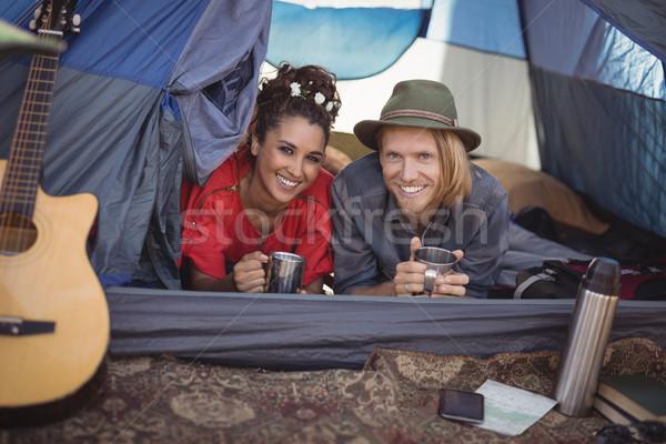 Smiling couple having tea in tent Stock photo © wavebreak_media