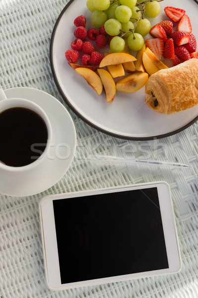Overhead view of digital tablet by coffee cup and fruits Stock photo © wavebreak_media