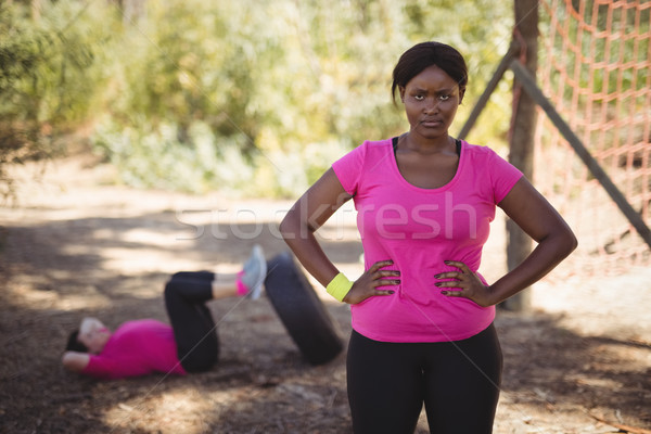 Portrait of woman standing with hands on hip during obstacle course Stock photo © wavebreak_media