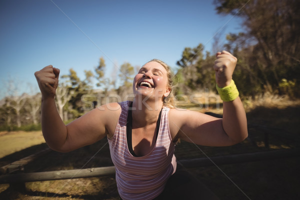 Happy woman cheering during obstacle course Stock photo © wavebreak_media