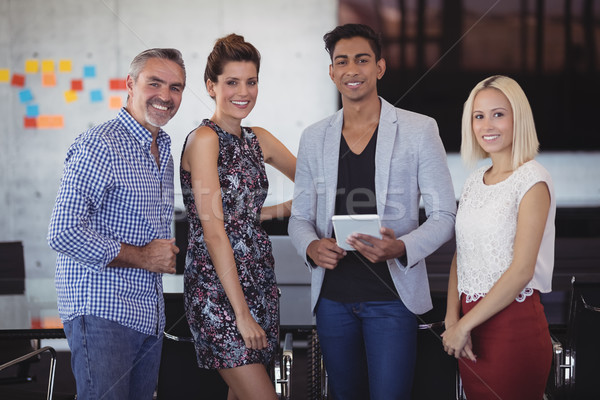 Portrait of smiling business team standing at creative office Stock photo © wavebreak_media