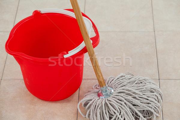 Empty bucket and mop on tile floor Stock photo © wavebreak_media