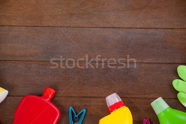 Various cleaning equipments arranged on wooden floor Stock photo © wavebreak_media